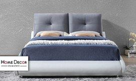 מיטה זוגית מרופדת בעיצוב מעוגל