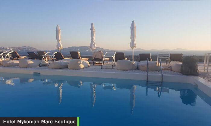 """11 דיל חגיגת קיץ: חופשה במיקונוס, האי הקסום ביותר ביוון, כולל סופ""""ש"""