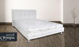 מיטת עץ מלא מרופדת