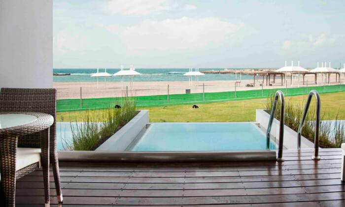 5 חופשה מפנקת ברצועת חוף לבנה ולגונות של מים צלולים